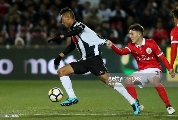 Benfica's defender Alejandro Grimaldo vies with Portimonense's defender Felipe during the Portuguese League football match between Portimonense SC...
