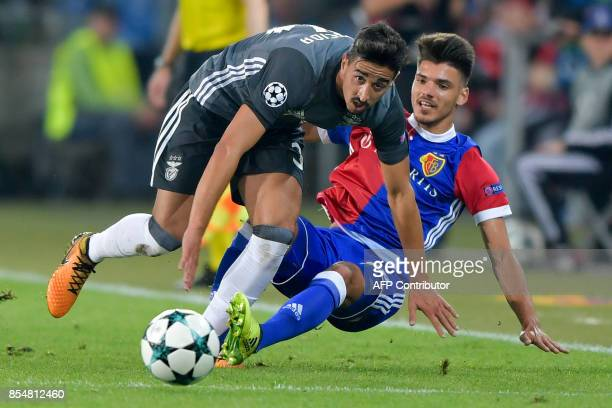 Benfica's defender Andre Almeida and Basel's Italian defender Raoul Petretta fight for the ball during the UEFA Champions League Group A football...