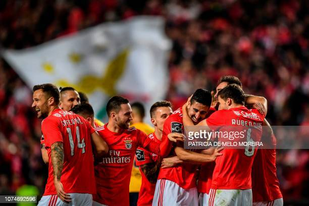 Benfica's defender Andre Almeida celebrates a goal with teammates during the Portuguese League football match between SL Benfica and Sporting CP at...
