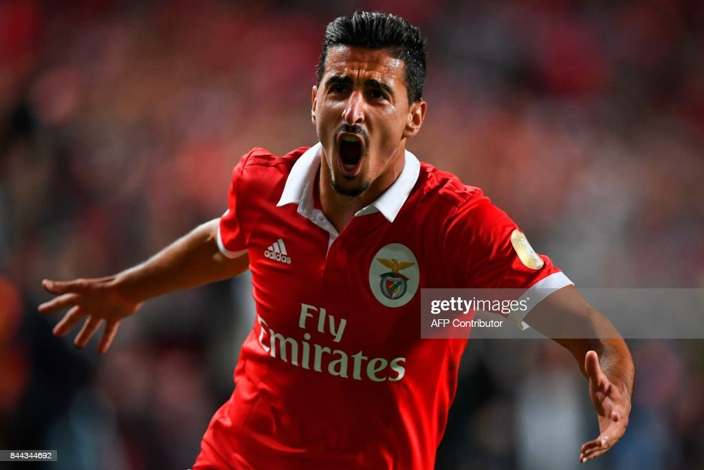 Benfica's defender Andre Almeida celebrates after scoring during the Portuguese league football match SL Benfica vs Portimonense SAD at the Luz stadium in Lisbon on September 8, 2017. /