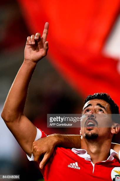 Benfica's defender Andre Almeida celebrates after scoring during the Portuguese league football match SL Benfica vs Portimonense SAD at the Luz...