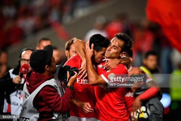 Benfica's defender Andre Almeida celebrates with his teammate Benfica's Brazilian forward Jonas Oliveira after scoring during the Portuguese league...