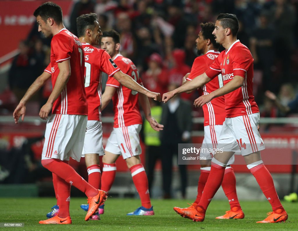 SL Benfica's defender Andre Almeida celebrates with teammate SL Benfica's forward from Brazil Jonas after scoring a goal during the Primeira Liga match between SL Benfica and CF Os Belenenses at Estadio da Luz on March 13, 2017 in Lisbon, Portugal.