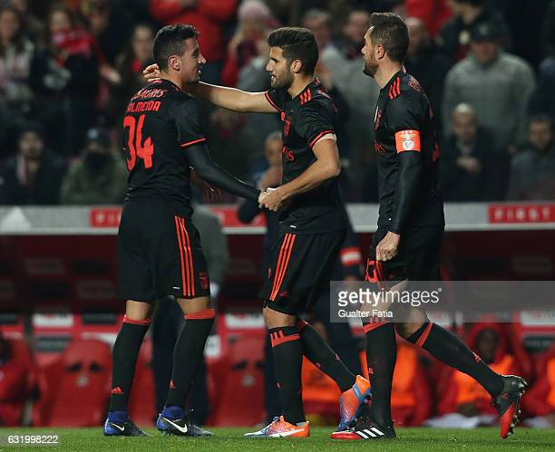 Benfica's defender Andre Almeida celebrates with teammates after scoring a goal during the Portuguese Cup match between SL Benfica and Leixoes at...
