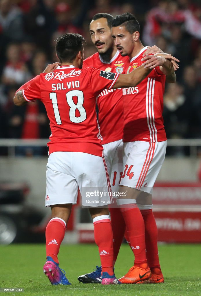 SL Benfica's defender Andre Almeida celebrates with teammates after scoring a goal during the Primeira Liga match between SL Benfica and CF Os Belenenses at Estadio da Luz on March 13, 2017 in Lisbon, Portugal.