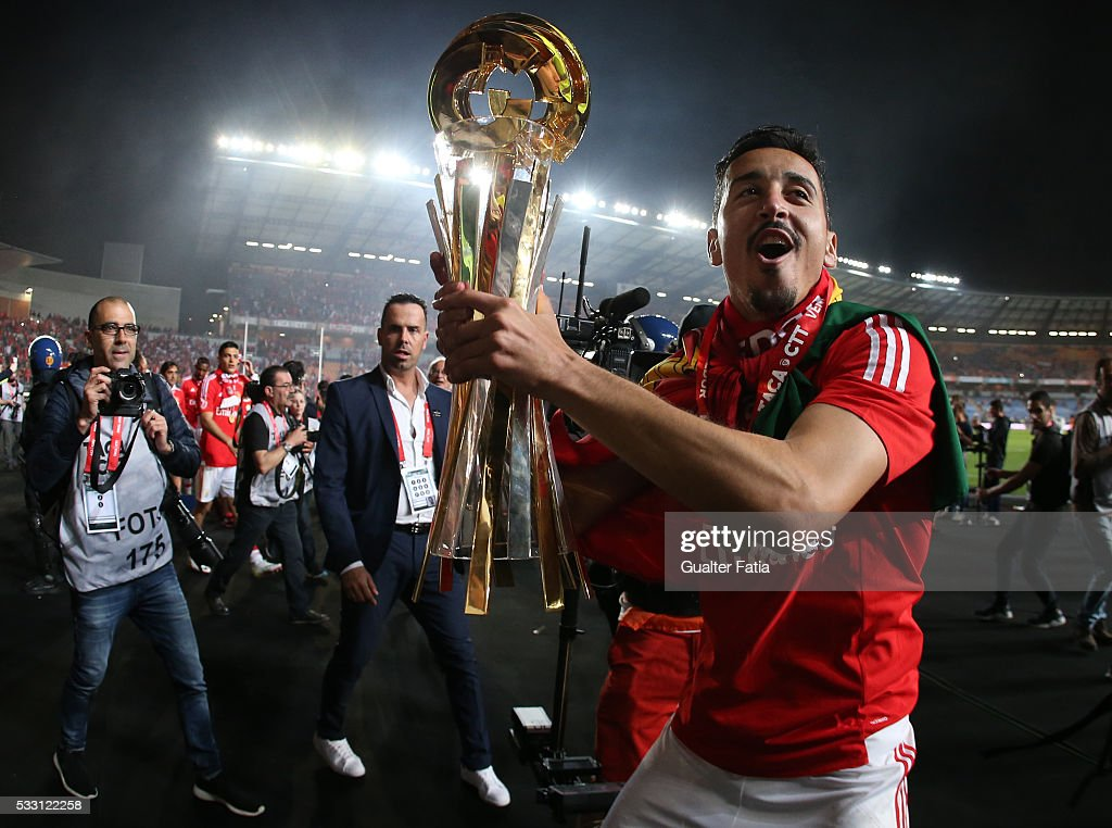SL Benfica's defender Andre Almeida celebrates with trophy after winning the Portuguese League Cup Title at the end of the Taca CTT Final match between SL Benfica and CS Maritimo at Estadio Efapel Cidade de Coimbra on May 20, 2016 in Coimbra, Portugal.