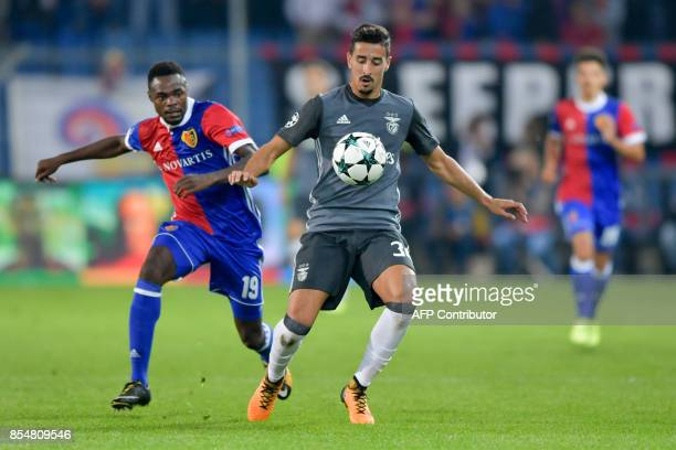 Benfica's defender Andre Almeida controls the ball next to Basel's Swiss forward Dimitri Oberlin during the UEFA Champions League Group A football...