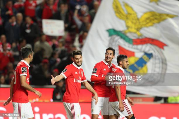 Benfica's defender Andre Almeida from Portugal celebrates scoring Benfica fifth goal with his team mates during the match between SL Benfica and FC...