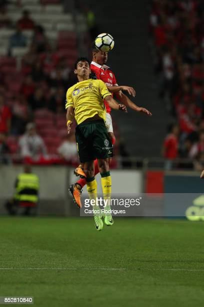 Benfica's defender Andre Almeida from Portugal higher that FC Pacos de Ferreira midfielder Vasco Rocha from Portugal heads the ball during the match...