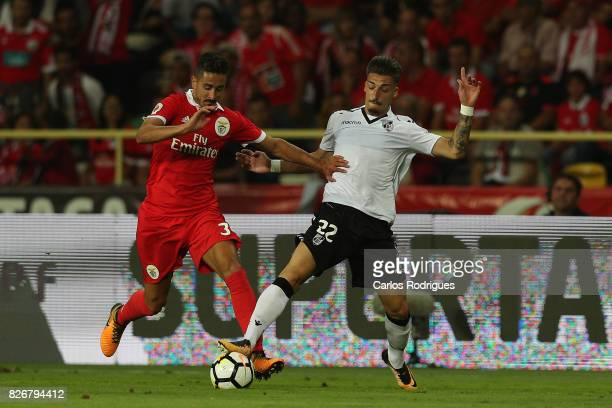 Benfica's defender Andre Almeida from Portugal vies with Guimaraes's forward Helder Ferreira from Portugal during the match between SL Benfica and...