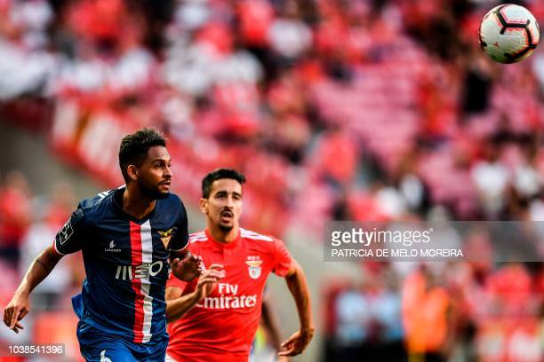 Benfica's defender Andre Almeida vies with Aves' Brazilian defender Vitor Costa during the Portuguese league football match between SL Benfica and CD...