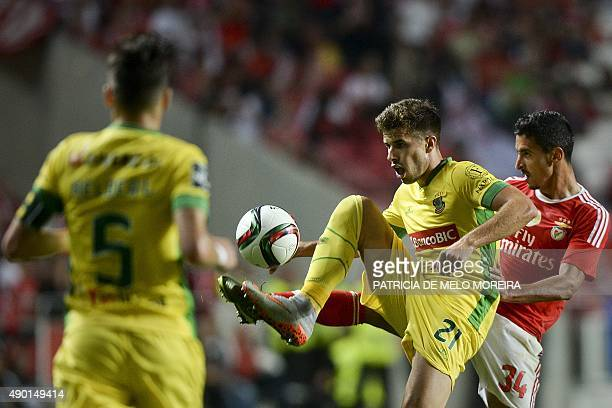 Benfica's defender Andre Almeida vies with Pacos de Ferreira's forward Joao Silva during the Portuguese league football match SL Benfica vs FC Pacos...