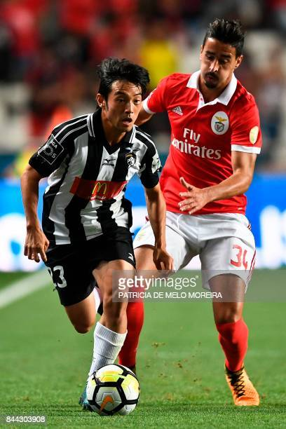 Benfica's defender Andre Almeida vies with Portimonense's Japanese forward Nakajima Shoya during the Portuguese league football match SL Benfica vs...