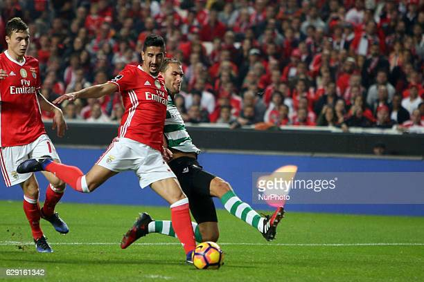 Benfica's defender Andre Almeida vies with Sporting's forward Bas Dost during the Portuguese League football match SL Benfica vs Sporting CP at the...