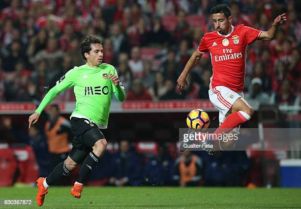 Benfica's defender Andre Almeida with Rio Ave FC's midfielder Filip Krovinovic in action during the Primeira Liga match between SL Benfica and Rio...
