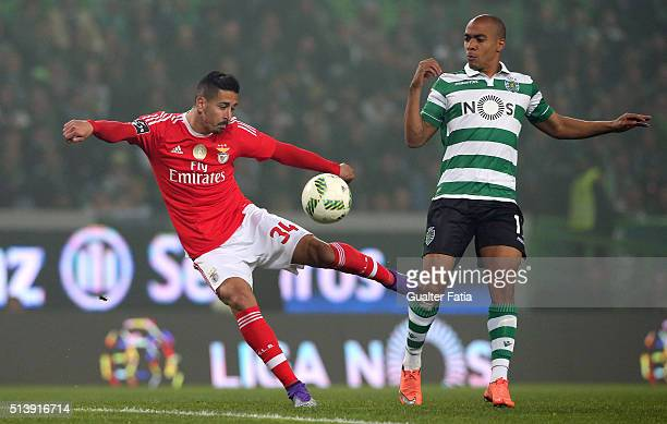 Benfica's defender Andre Almeida with Sporting CP's midfielder Joao Mario in action during the Primeira Liga match between Sporting CP and SL Benfica...
