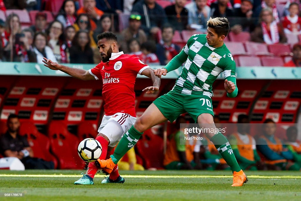 Benfica's defender Douglas (L) vies for the ball with Moreirense's forward Ronaldo Pena (R) during the Portuguese League football match between SL Benfica and Moreirense FC at Luz Stadium in Lisbon on May 13, 2018.