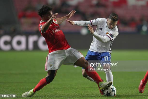 Benfica's defender Eliseu from Portugal vies with Fc Basel forward Renato Steffen from Switzerland for the ball possession during SL Benfica v FC...
