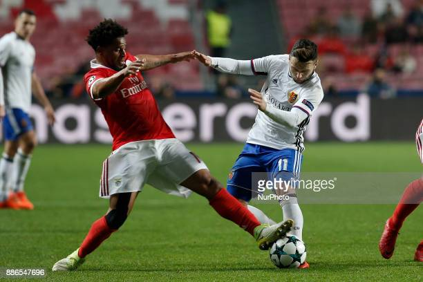 Benfica's defender Eliseu vies for the ball with Basel's midfielder Renato Steffen during Champions League 2017/18 match between SL Benfica vs FC...