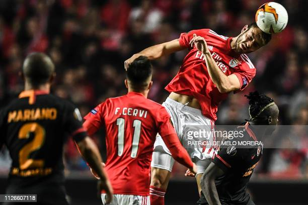 Benfica's defender Francisco Ferro heads the ball during the UEFA Europa League round of 32 second leg football match between SL Benfica and...