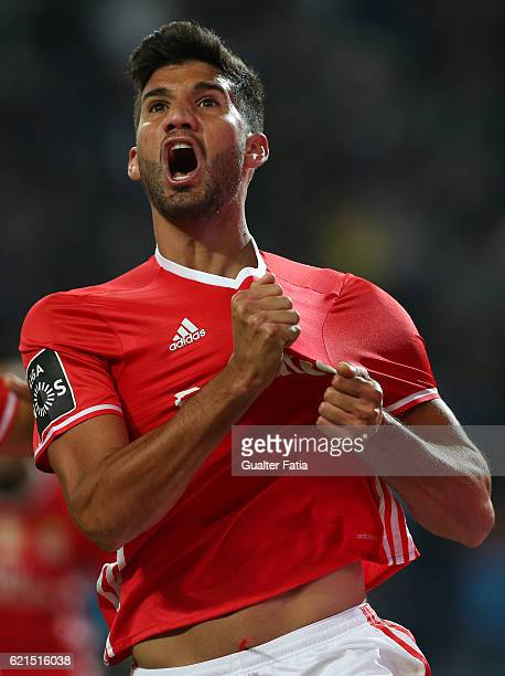 Benfica's defender from Argentina Lisandro Lopez celebrates after scoring a goal during the Primeira Liga match between FC Porto and SL Benfica at...