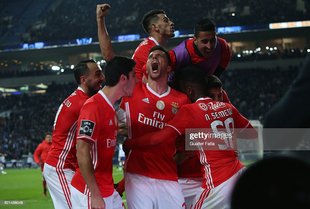 SL Benfica's defender from Argentina Lisandro Lopez celebrates with teammates after scoring a goal during the Primeira Liga match between FC Porto and SL Benfica at Estadio do Dragao on November 6, 2016 in Porto, Portugal.