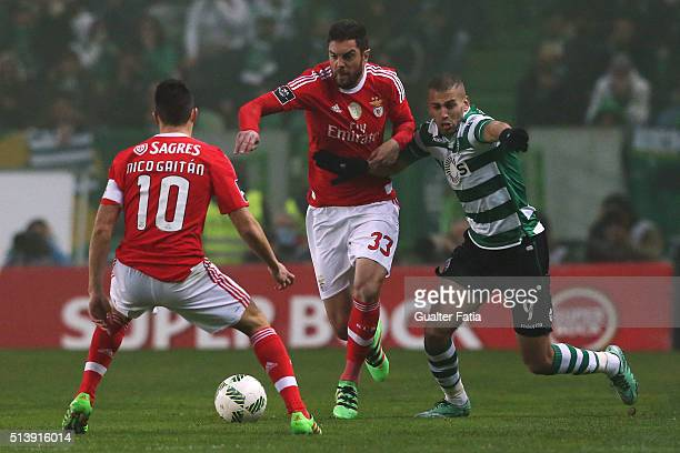 Benfica's defender from Brazil Jardel with Sporting CP's forward Islam Slimani from Algeria in action during the Primeira Liga match between Sporting...