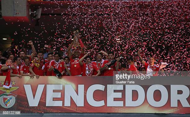 Benfica's defender from Brazil Luisao and teammates celebrate with trophy after winning the Portuguese League Cup Title at the end of the Taca CTT...