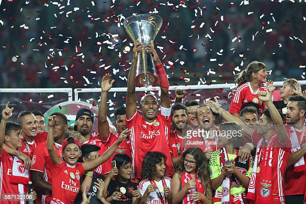 Benfica's defender from Brazil Luisao and teammates celebrate with trophy after winning the Portuguese Super Cup Title at the end of the Super Cup...