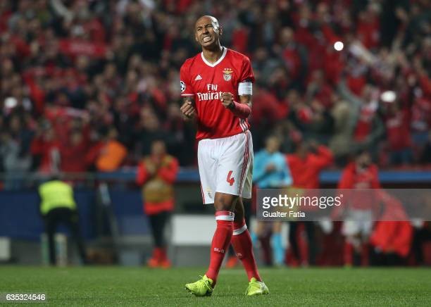 Benfica's defender from Brazil Luisao celebrates the victory at the end of the UEFA Champions League Round of 16 First Leg match between SL Benfica...