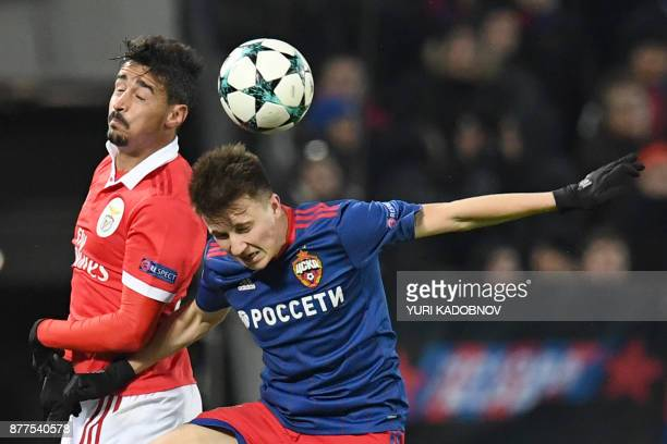 Benfica's defender from Portugal Andre Almeida and CSKA Moscow's midfielder from Russia Aleksandr Golovin vie for the ball during the UEFA Champions...