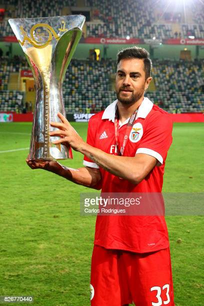Benfica's defender Jardel Vieira from Brasil with the Portuguese Super Cup trophy after the match between SL Benfica and VSC Guimaraes at Estadio...