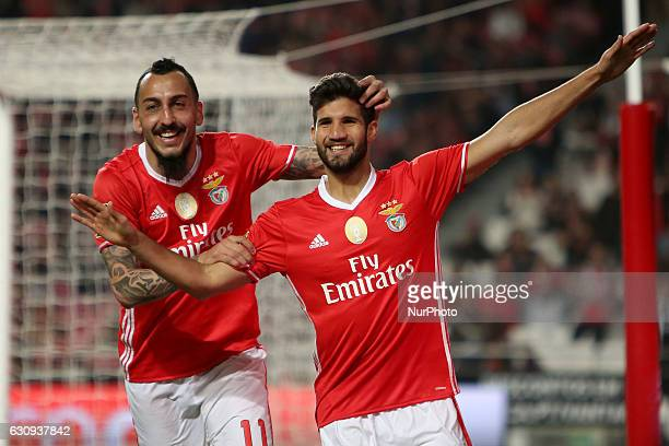 Benfica's defender Lisandro Lopez celebrates with Benfica's forward Kostas Mitroglou after scoring a goal during the Portuguese League Cup football...