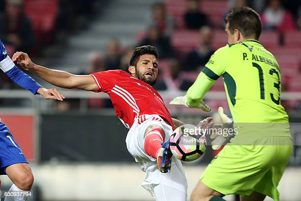 Benfica's defender Lisandro Lopez fights for the ball with Vizela's goalkeeper Pedro Albergaria during the Portuguese League Cup football match SL...