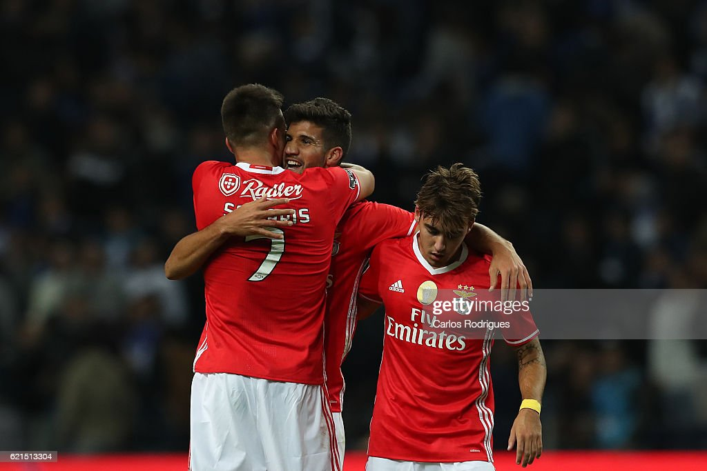 Benfica's defender Lisandro Lopez from Argentina celebrates scores Benfica«s goal with Benfica's midfielder Andreas Samaris from Greece and Benfica's midfielder Andre Horta from Portugal during the FC Porto v SL Benfica - Primeira Liga match at Estadio do Dragao on November 06, 2016 in Porto, Portugal.