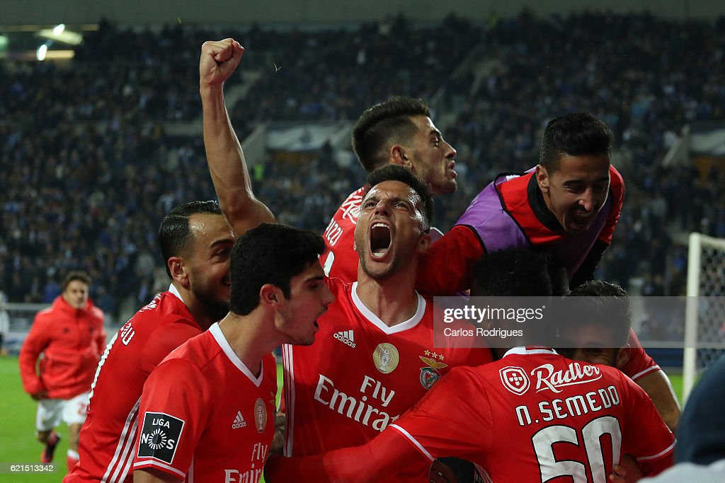 Benfica's defender Lisandro Lopez from Argentina celebrates scores Benfica«s goal with his team mates during the FC Porto v SL Benfica - Primeira Liga match at Estadio do Dragao on November 06, 2016 in Porto, Portugal.