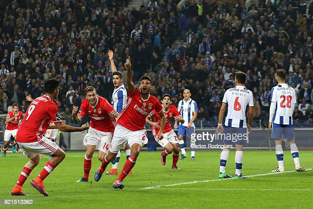 Benfica's defender Lisandro Lopez from Argentina celebrates scores Benfica«s goal during the FC Porto v SL Benfica Primeira Liga match at Estadio do...