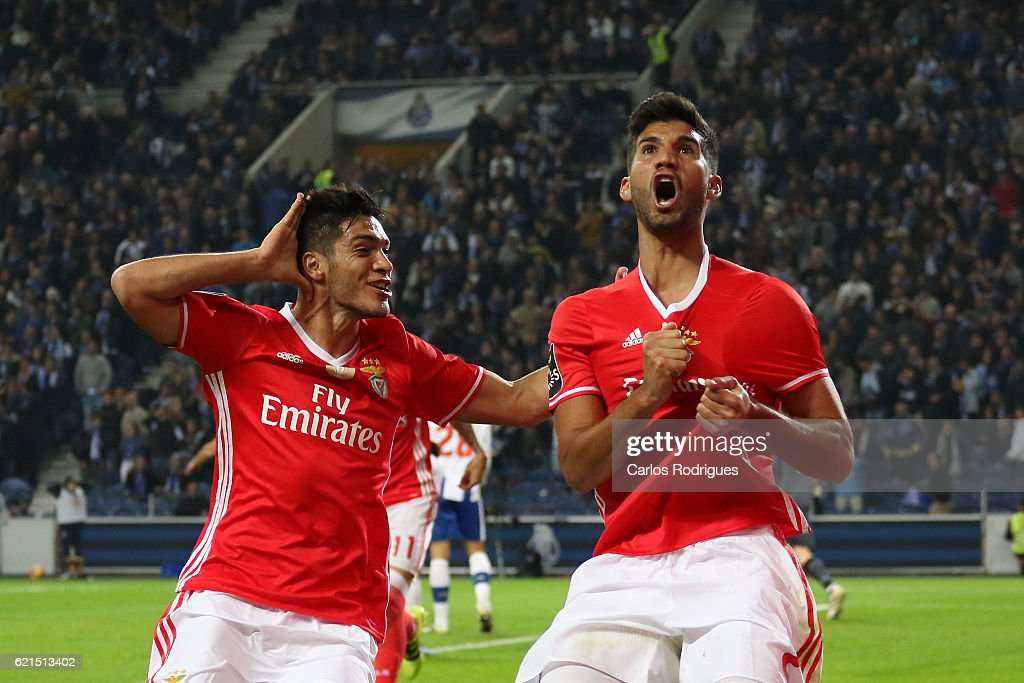 Benfica's defender Lisandro Lopez from Argentina celebrates scores Benfica«s goal with Benfica's forward Raul Jimenez from Mexico during the FC Porto v SL Benfica - Primeira Liga match at Estadio do Dragao on November 06, 2016 in Porto, Portugal.