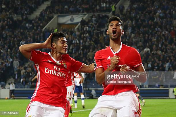 Benfica's defender Lisandro Lopez from Argentina celebrates scores Benfica«s goal with Benfica's forward Raul Jimenez from Mexico during the FC Porto...