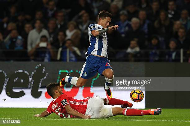 Benfica's defender Lisandro Lopez from Argentina tackles FC PortoÕs forward Otavio from Brazil during the FC Porto v SL Benfica Primeira Liga match...