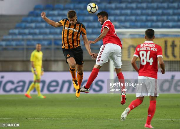 Benfica's defender Lisandro Lopez from Argentina with Hull City midfielder Markus Henriksen in action during the Algarve Cup match between SL Benfica...
