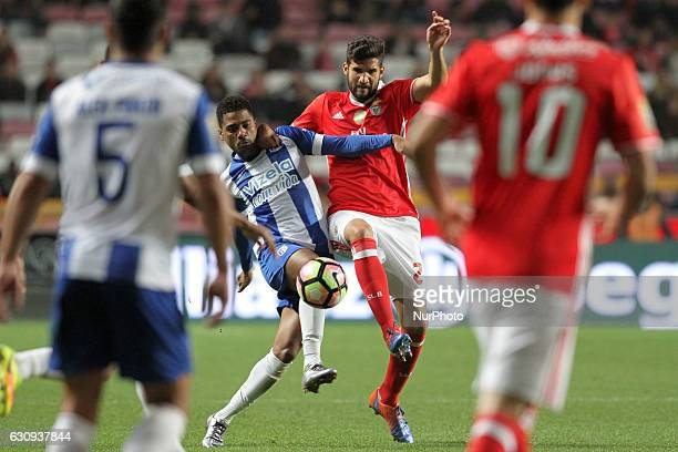 Benfica's defender Lisandro Lopez vies with Vizela's forward Kukula during the Portuguese League Cup football match SL Benfica vs FC Vizela at the...