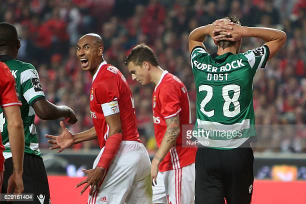 Benfica's defender Luisao and Sporting's forward Bas Dost react during the Portuguese League football match SL Benfica vs Sporting CP at the Luz...