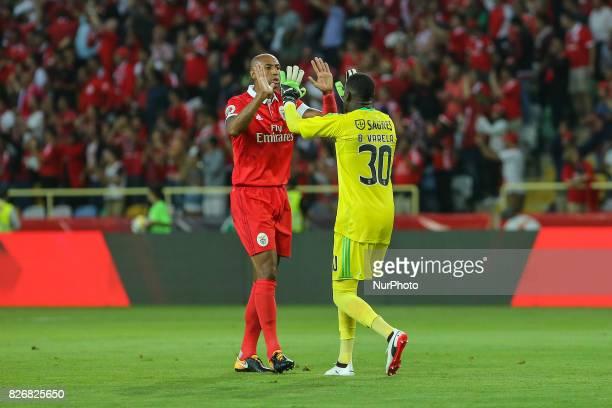 Benficas defender Luisao from Brazil and Benficas goalkeeper Bruno Varela from Portugal celebrating a goal scored by Benficas forward Jonas from...