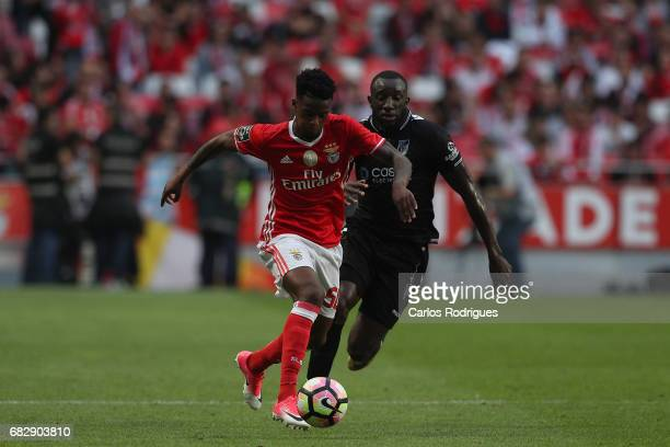 Benfica's defender Nelson Semedo from Portugal vies with Vitoria Guimaraes forward Moussa Marega from Mali during the match between SL Benfica and...
