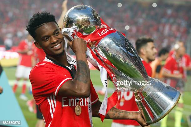 Benfica's defender Nelson Semedo holds the cup after winning their 36th title at the end of the Portuguese league football match SL Benfica vs...