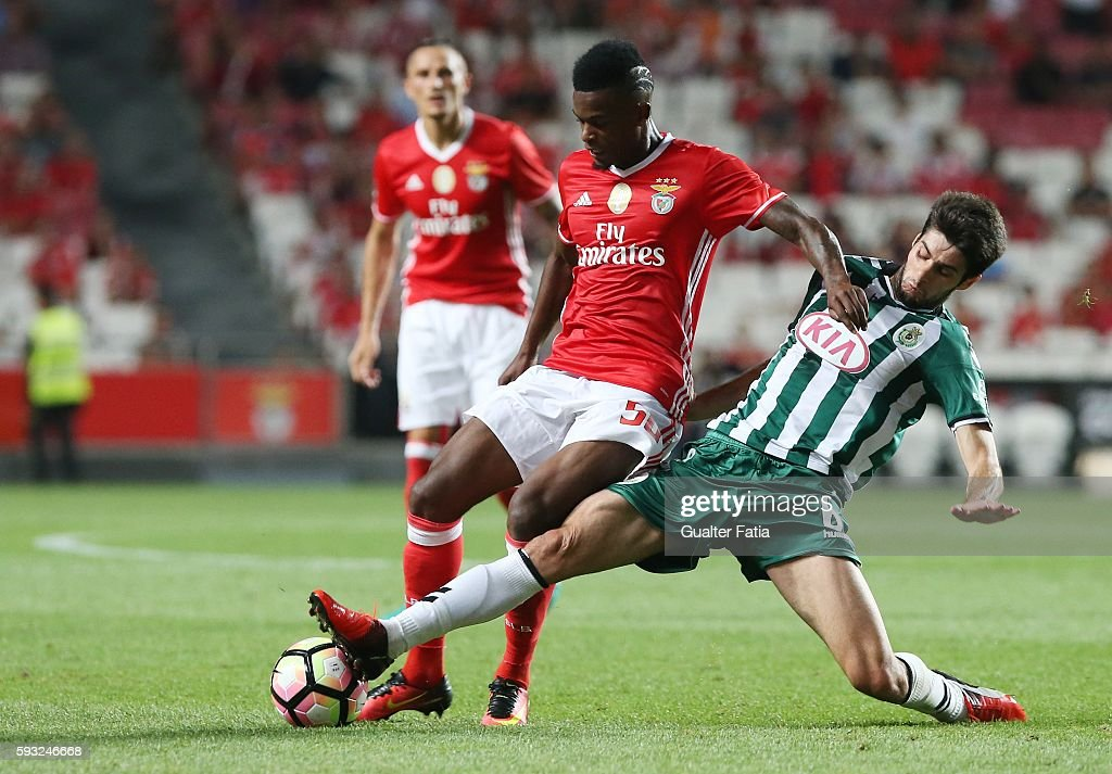 SL Benfica's defender Nelson Semedo (L) tackled by Vitoria de Setubal's midfielder Fabio Pacheco (R) during the Primeira Liga match between SL Benfica and Vitoria de Setubal at Estadio da Luz on August 21, 2016 in Lisbon, Portugal.