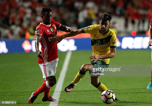 Benfica's defender Nelson Semedo vies for the ball with Pacos Ferreira's forward Ivo Rodrigues during Premier League 2016/17 match between SL Benfica...