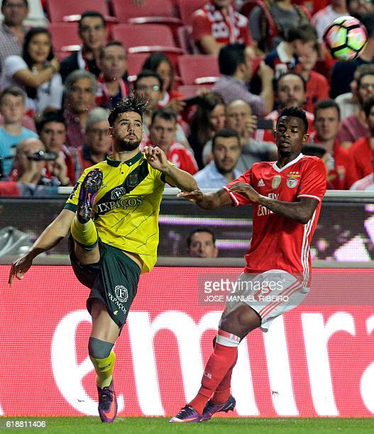 Benfica's defender Nelson Semedo vies with Pacos Ferreira's defender Miguel Vieira during the Portuguese league football match between SL Benfica and...