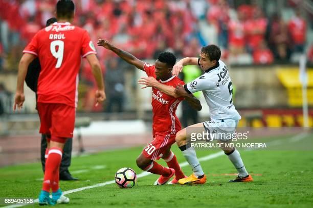 Benfica's defender Nelson Semedo vies with Vitoria Guimaraes' Brazilian Rafael Miranda during the Portugal's Cup final football match SL Benfica vs...